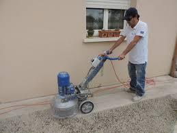 using a concrete grinder